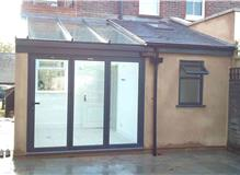 Extension comprising utility room, downstairs WC and conservatory