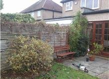 Garden makeover  Fencing  patio  turf and sleeper beds.