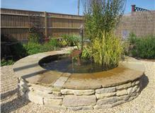 Central raised stone feature inc bespoke copper fountain