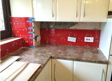 Remove existing tiles and tile kitchen and utility area