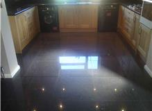 Laying floor tiles in kitchen and dining room and wall tiles in kitchen