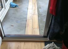 Removal of existing wood flooring in our conservatory and replacing with tiles.