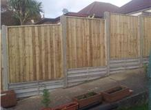 Concrete retaing boards and close boarded panel fencing