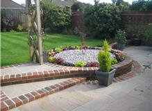 Patio with raised brick flower bed