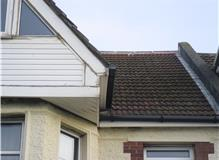 repair to gutter ,front of house arrow roofing services