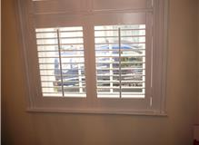 Tier on Tier shutters with tilt rods and centre bar