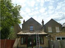 Complete replacement of sloping roof to extension