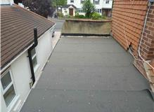 Replaced flat roof to converted garage.