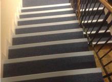 Laying new corridor carpets.