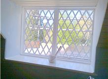 Window and surround repaired painted and filled