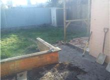 Level garden and lay new path, patio, decking and turf