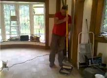 Applying hard wax oil to a sanded parkay flooring