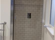 Shower Wall Tiling With Metro Tiles In A Brick Pattern.
