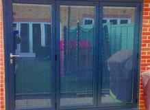 Origin bifold door with inscreen blinds