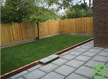 Complete Garden Design using Grey Textured Slabs for the Patio