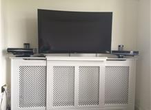 An amazing curved Samsung 4K TV mounted on a full motion bracket