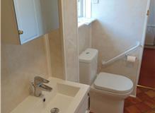 Installation of 'comfort height' toilet