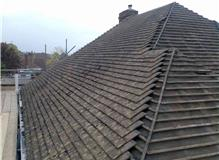 STRIP AND RETILE ROOF, TAKE CHIMNEY TO BUNGALOW CEILING HEIGHT AND FIT VELUX WINDOW