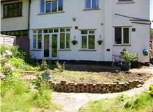 Patio, walling, steps, lawn and feature circles.