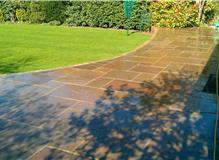 Laid sandstone patio and re turf lawn.